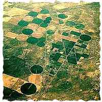 Looking like a quilt in this aerial shot, green or brown circles show the coverage of center-pivot irrigators.